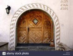 Entrance of an Engadin house decorated with Sgraffito ornaments from the 17th centuary, Samedan, Engadin, Grisons, Switzerland Stock Photo