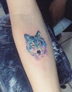 Small Watercolor Wolf Tattoo
