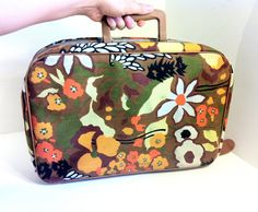 1970s Flower Power Mini Suitcase. $25.00, via Etsy So cute!