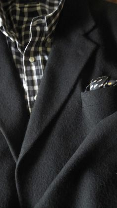 Favorite Traveling Companion: black cashmere/unstructured sport jacket and woven check shirt.