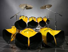 Drums don't need to be drumcage-d in. Rare & unique & beautiful set of NORTH DRUMS, which are HORN SHAPED drums designed to project their sound outward, so the audience can hear the most direct qualities of the drum. These yellow drums go a step further in the joy of loud drumming- The built in acoustic amplification & well organized drumkit will give joy to most any drummer. -DdO:) http://www.pinterest.com/DianaDeeOsborne/drums-drumming-joy