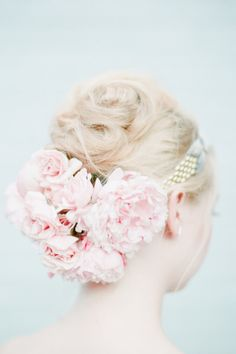 A headband with peonies and roses in the back: http://www.stylemepretty.com/2013/10/14/after-wedding-inspiration-from-michelle-edgemont-brklyn-view-photography/   Photography: Brklyn View - http://www.brklynview.com/