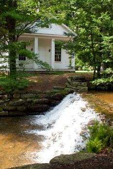 A creek flows over a dam in front of a white, historic chapel at Hickory Run State Park, Pennsylvania http://www.dcnr.state.pa.us/stateparks/findapark/hickoryrun/