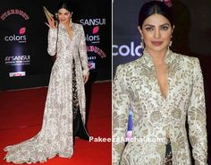 Priyanka Chopra was seen in a high trailing stop with slit designed by Anamika Khanna on the red carpet at the Stardust Awards 2016. Trailing top had a high collar neck with a deep neck in V-shape for the event. Priyanka Chopra was styled with Nirav modi Jewellery and tightly fitted hair parted...