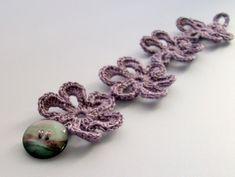 Purple Bracelet Flower Crochet Jewelry Button Detail. £8.00, via Etsy.