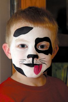Dalmatian inspired Halloween mask. Love dogs? Get creative with face paint makeup and draw Dalmatian spots, a cute doggy nose and a tongue to complete the canine feel.
