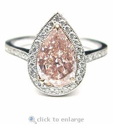 Ziamond Cubic Zirconia 5 Carat Pear 14x9 CZ Solitaire Engagement Ring 14K Gold.  The Angelika Ring features a stunning pink center cubic zirconia pear adorned by pave set round cz.  This ring is available in your choice of center stone colors as well as the traditional diamond look option.  $3495 #ziamond #cubiczirconia #cz #jewelry #diamond #ring #solitaire #engagementring #14kgold