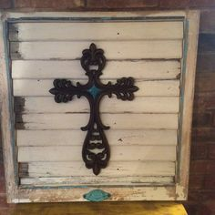 Turquoise Cross on old window frame