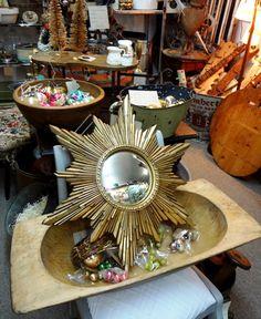 Midcentury syroco convex sunburst mirror.