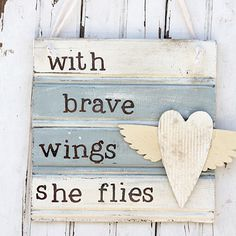 With Brave Wings She Flies Sign
