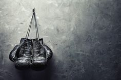 old boxing gloves hang on nail on texture wall Vinyl Wall Mural ✓ Easy Installation ✓ 365 Day Money Back Guarantee ✓ Browse other patterns from this collection!