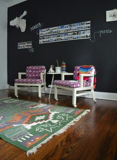A chalkboard accent wall in the home office provides a space for travel photos.