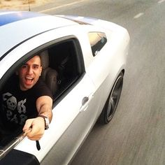 This gentleman who should really be watching the road. | 31 People Who Took The Selfie Stick To A Whole New Level