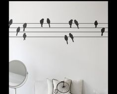 Powerbirds (2041-01) - Ferm Living Stickers - 12 black birds and 20 metres of powerline – to put together as you please. Printed on vinyl, easy to apply and remove from any smooth surface.  Sheet size 100cm x 50cm.