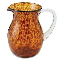 Tortoise glass pitcher features pouring spout and clear glass handle. #pitcher #features #Tortoise