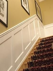 white wall moulding on staircase.like this recessed squares better then the raised moulding trimmed in squares.
