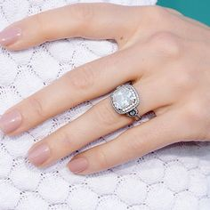 Brides.com: . Jessica Biel's Engagement Ring. Jessica Biel's once elusive engagement ring from love Justin Timberlake features a slightly rounded square-cut diamond surrounded by two rows of smaller stones. Notable details include scrolling rope-style sides and the use of blackened platinum, which creates a unique, vintage effect.