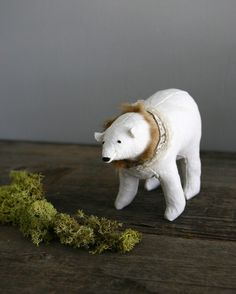 """""""ah, they've put me next to a stick to make things rustic again"""" polar bear from everyeskimo."""