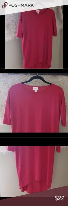 "LuLaRoe Irma XXS High Low S/S Pink Solid Tunic Tee LuLaRoe Irma T Shirt.  Size extra extra small.  Solid pink.  High low.  Mid length sleeves.  60% modal, 40% polyester.  Machine wash cold.  23"" pit to pit, 32"" shoulder to back hem.  In good, preowned condition.  No trades, offers welcome. LuLaRoe Tops Tees - Short Sleeve"