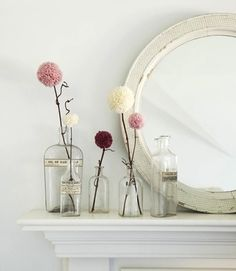 simple mantle with vintage bottles and mirror.