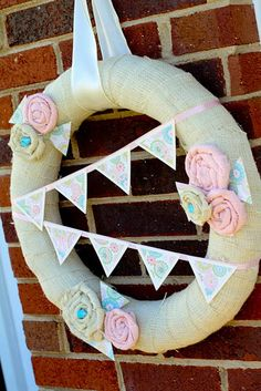 Burlap wreath. (Do red flags and little bears instead of flowers)