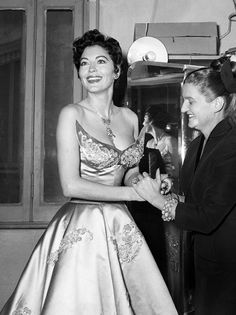 Ava Gardner wearing a dress by Sorelle Fontana, Rome, 1954. She was in Rome for the filming of The Barefoot Contessa at Rome's Cinecittà Studios.