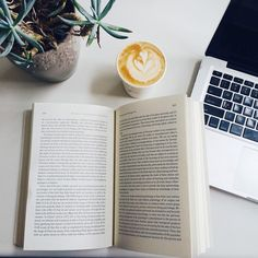 a book, a laptop, and coffee.