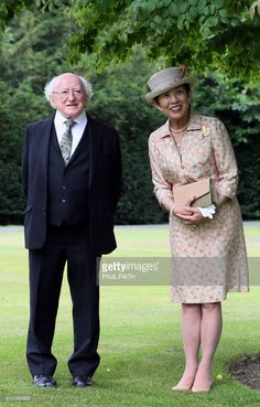 HIH Princess Takamado of Japan (R) and Irish President, Michael D Higgins walk through the gardens of his residence, Aras an Uachtarain, where she visited a Kaduura tree planted by Crown Prince Akihito in 1985, at Phoenix Park, Dublin on July 7, 2017, during her visit to the country. / AFP PHOTO / Paul FAITH