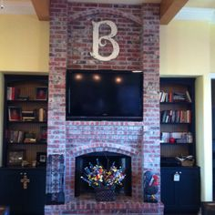 "Love this big ""B"" I found at an antique show. It wasn't antique, but it looks old and goes perfectly over the fireplace."