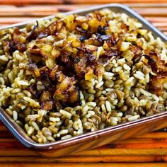 Mujadarra (Middle Eastern Lentils and Rice with Caramelized Onions)    3/4 cup rice (or bulgar, quinoa)  1 cup brown lentils, rinsed  3 cups yellow onions, cut into quarter slices (or more)  1/3 cup olive oil (use high-quality olive oil with good flavor for this dish)  1/4 tsp. ground cumin    Optional - cardamom pods, cinnamon, nutmeg