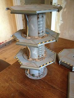 Terrain Tutorials, including how to make this tower! I would want to make the ladders more like the caged ones in industrial shipyards, but it's still really cool