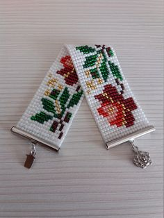 This amazing bracelet with floral pattern reflects the beauty and simplicity of Northern Romania-Maramuresh County. The pattern was taken from an old Romanian traditional blouse and tells you never-ending stories about the history of feminity in this part of the world. The platinium flower