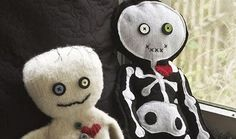 DIY Skeleton doll..... I like the one on the right with a possibly larger eyeball on one side.