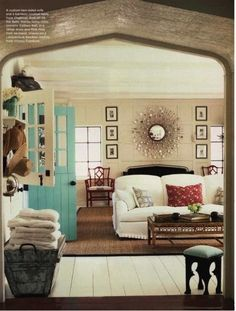 Love the door colour, sunburst mirror with pictures on both sides