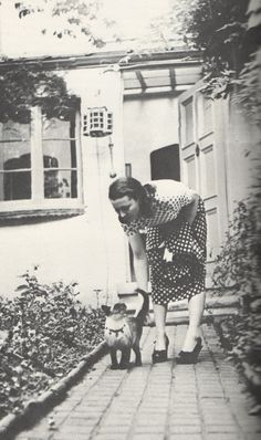 Vivien and her cat in her cottage