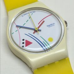 Vintage Ladies Swatch Watch 1987 This is a vintage Ladies Swatch Watch from 1987. It is running and keeping perfect time with a new and included battery. Brand new, unworn yellow replacement bands. I took them out of the original packaging myself minutes before taking the photos. No cracks or chips anywhere. Fantastic condition. Swatch Jewelry