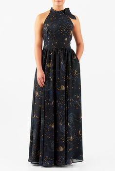 Our timeless halterneck maxi dress cut from constellation print georgette will sculpt and smooth your silhouette to elegantly conceal with seam detailing to contour.