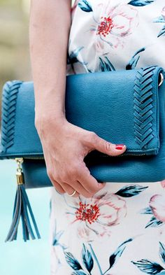 Soft teal foldover clutch with beautifully braided side detailing and a tassel on the zipper