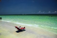 CHAIR ON THE BEACH (EXPOSURE COLOR STRETCH SETTING) by MOOSE COLLECTOR, via Flickr