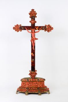 This very luxurious work is from Trapani in Sicilia. A Very Rare 17th Century Coral and Tortoiseshell Crucifix.  The Christ is in coral on a Cross in tortoiseshell.  The stand is in gilded brass ,silver and coral .