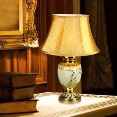 Gold table lamp  Find more inspirations: www.luxxu.net #luxurylighting #lightingdesign #tablelamps