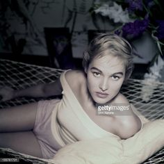 Photo d'actualité : Swiss actress Ursula Andress poses in a hammock,...