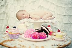 baby on a cake plate with desserts, newborn tea party portraits Emily Heizer Photography with Flair