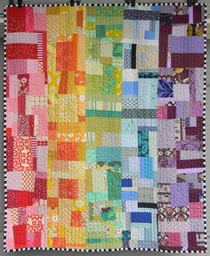 Scrap rainbow quilt by Teaginny Designs.  Inspired by a Blue Elephant Stitches quilt.