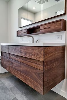 Walnut Floating Vanity and Medicine Cabinet designed, built, and installed by Bill Fry Construction.