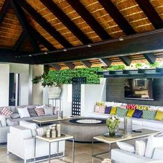 A Beautifully Thatched Roof Covers A Plush Seating Corner