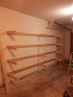 DIY Garage Shelves 28 Years old and this is my first DIY project since woodworking class in High School. Garage Storage Shelves, Garage Storage Solutions, Garage Shelf, Diy Storage, Garage Doors, Garage Workbench, Storage Ideas, Storage Systems, Garage Wall Shelving