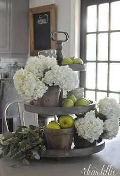 We found some faux apples at HomeGoods to add to our real pears to help fill out our three tiered tray on our kitchen table. (sponsored pin)
