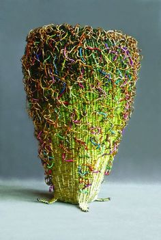 "Marilyn Moore ""Confetti"", Twined, wrapped and woven wire basket competed in 2012. 8"" x 5.5""."