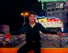 Michael Jackson Gif. riding on top of car.. very cute